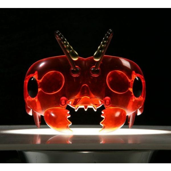 Mask in dark place in spotlight